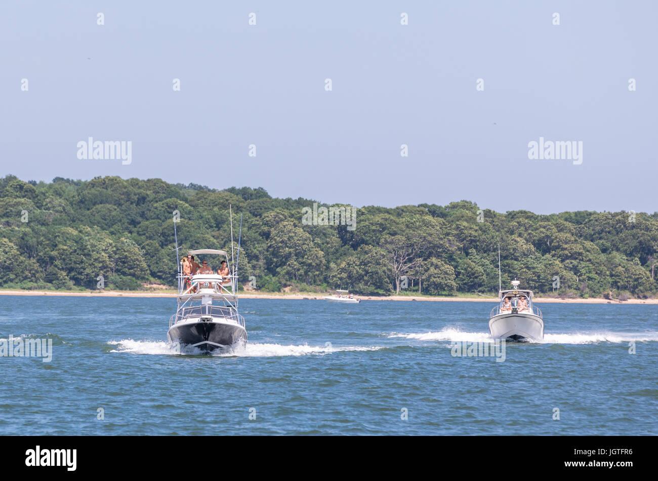 two power boats underway of shelter island, ny - Stock Image