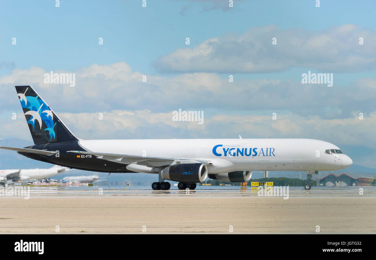 Aircraft Boeing 757 Cynus Air cargo airline, is arriving to the cargo parking, after it has landed in Madrid - Barajas, - Stock Image
