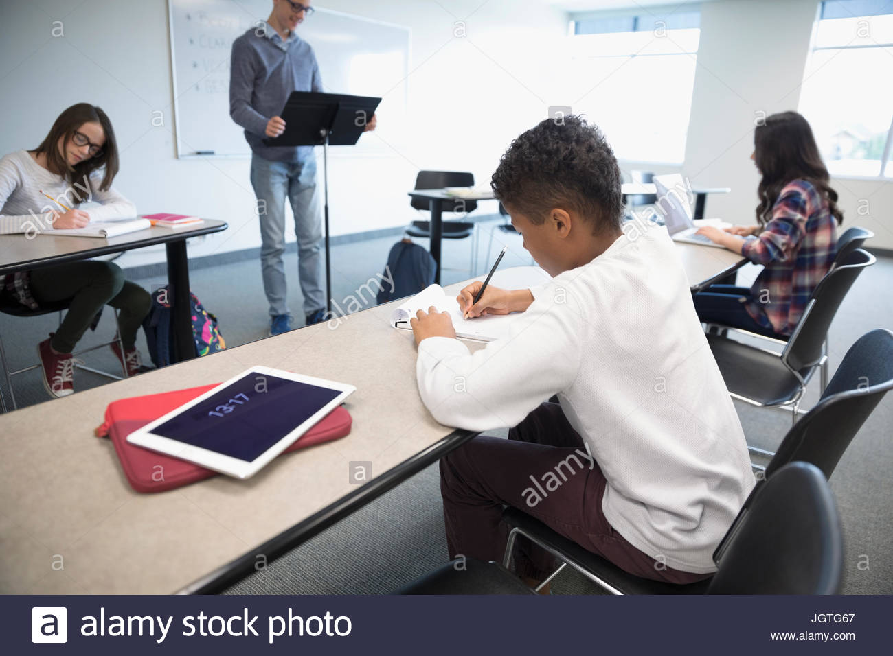 Middle school students in debate club in classroom - Stock Image