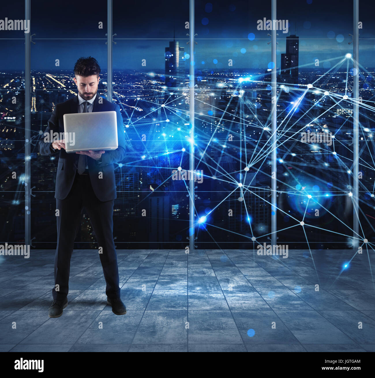 Businessman works with laptop and internet network - Stock Image