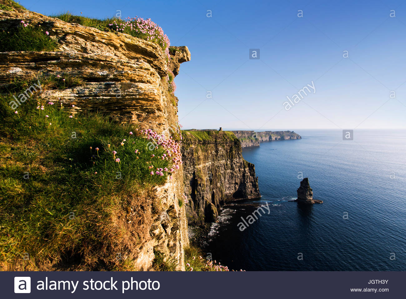 Sunlight shines on the Cliffs of Moher. - Stock Image