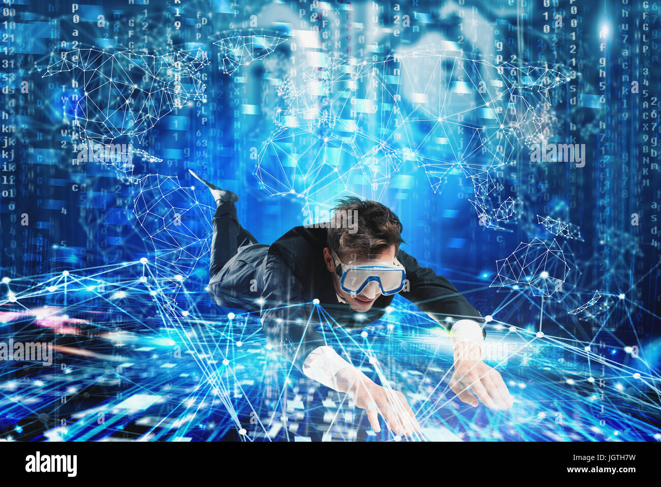 Businessman surfing the internet underwater with mask. Internet exploration concept - Stock Image