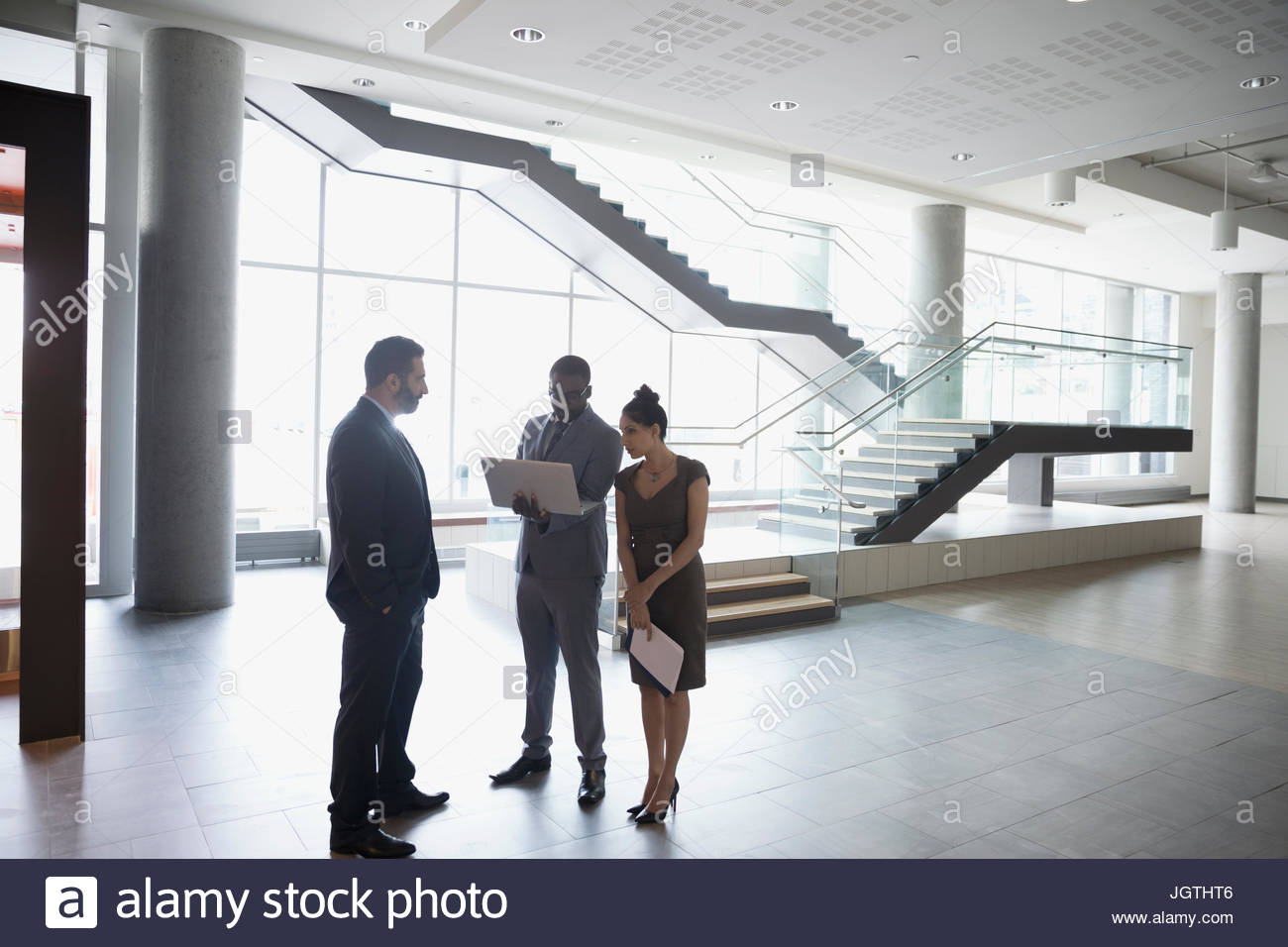 Modern office lobby High Tech Office Business People Talking Using Laptop In Modern Office Lobby Stock Image Studio7creativeco Modern Office Lobby Stock Photos Modern Office Lobby Stock Images