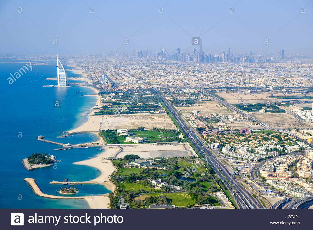 Aerial photo of Jumeirah beach, with the Burj Al Arab and downtown Dubai in the background - Stock Image