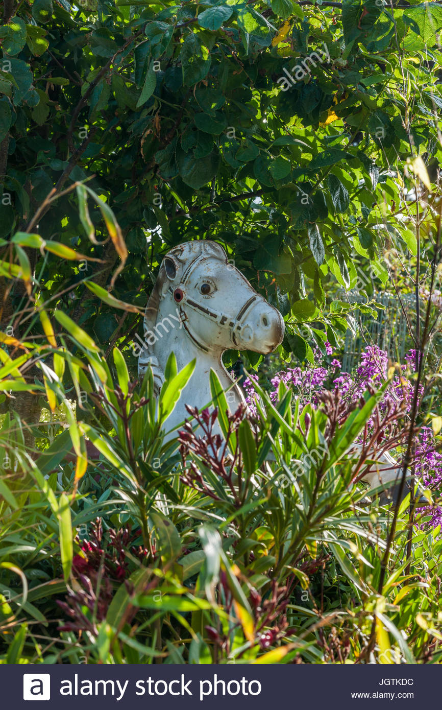 roundabout horse at Driftwood garden - Stock Image