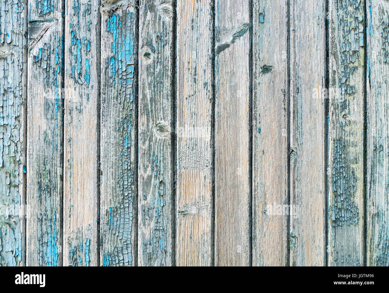 Old wood planks with paint peeling off. - Stock Image