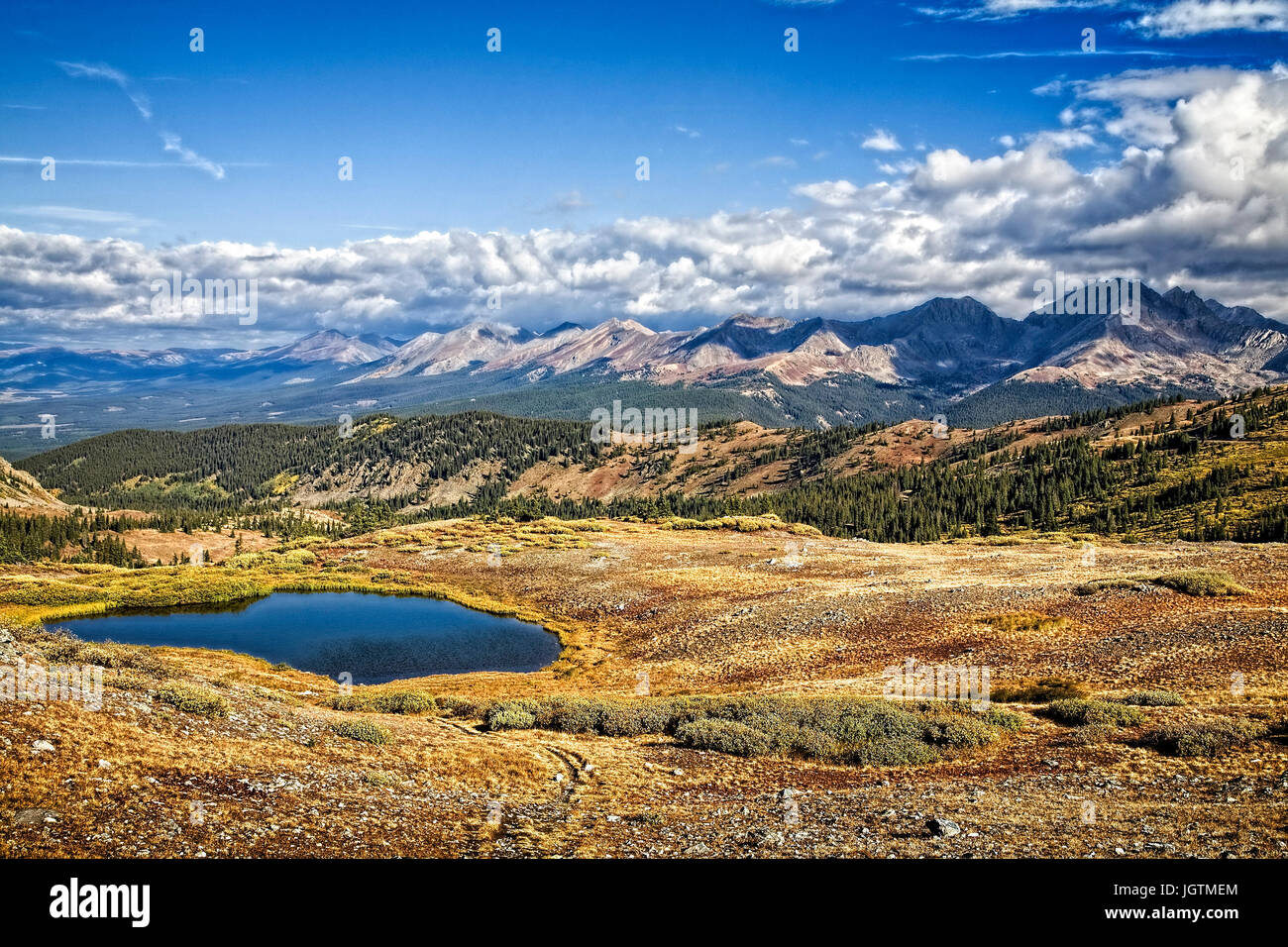 A small lake sits high in the Colorado Rockies on Ohio Pass road west of Buena Vista, Colorado - Stock Image