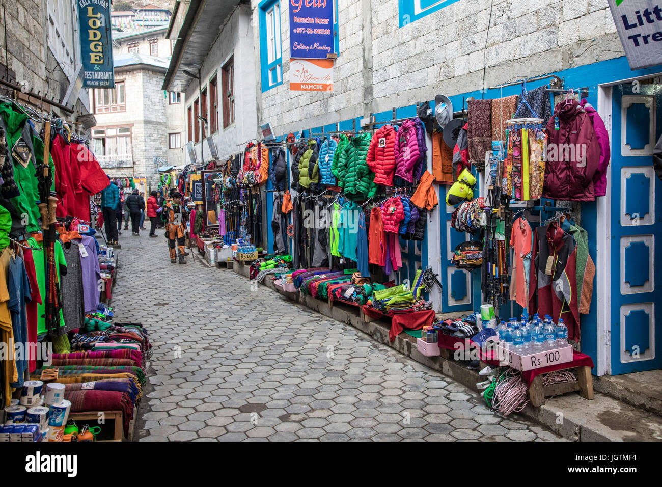 Climbing, trekking, and outdoor gear included in the any thing you need market in Namche Bazaar on the way to Mt. - Stock Image