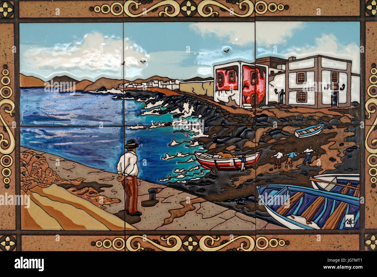 Tile picture shows a coast landscape with fishing boats, Puerto del Carmen, Lanzarote island, Canary islands, Spain, - Stock Image