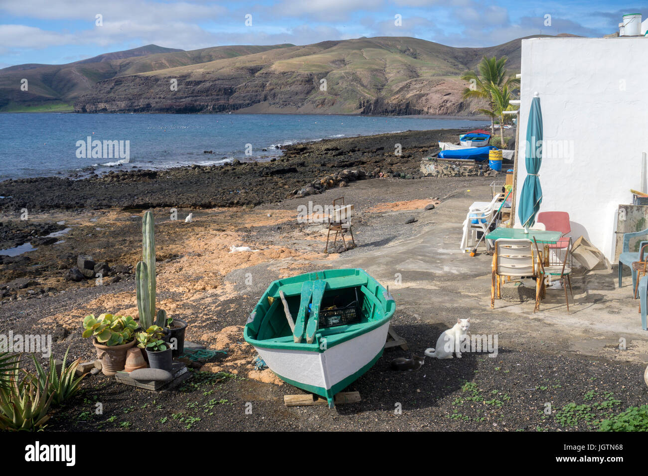 Fishing boats at the beach of the fishing village Playa Quemada, Lanzarote island, Canary islands, Spain, Europe Stock Photo