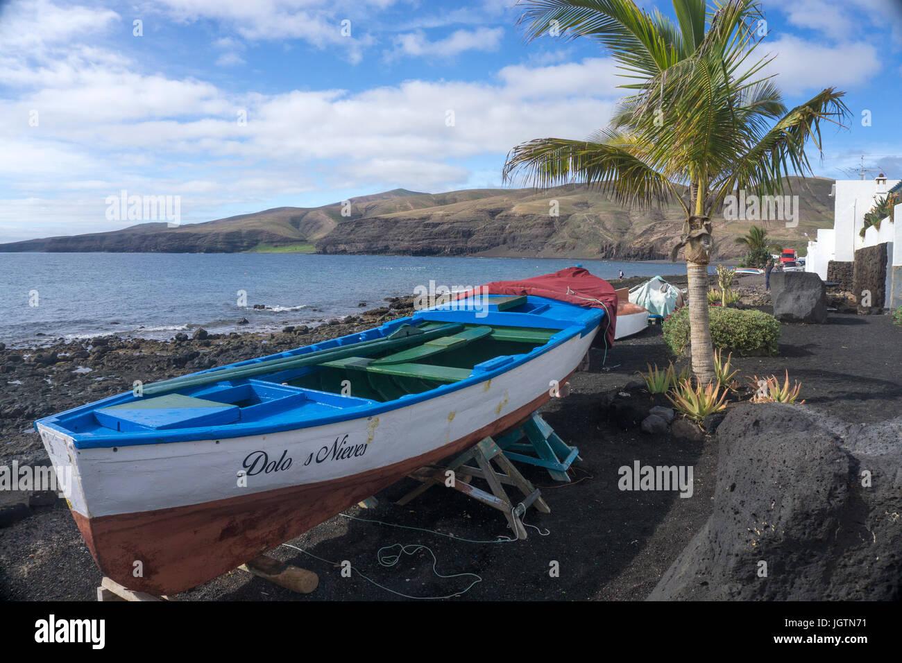 Fishing boats at the beach of the fishing village Playa Quemada, Lanzarote island, Canary islands, Spain, Europe Stock Photo