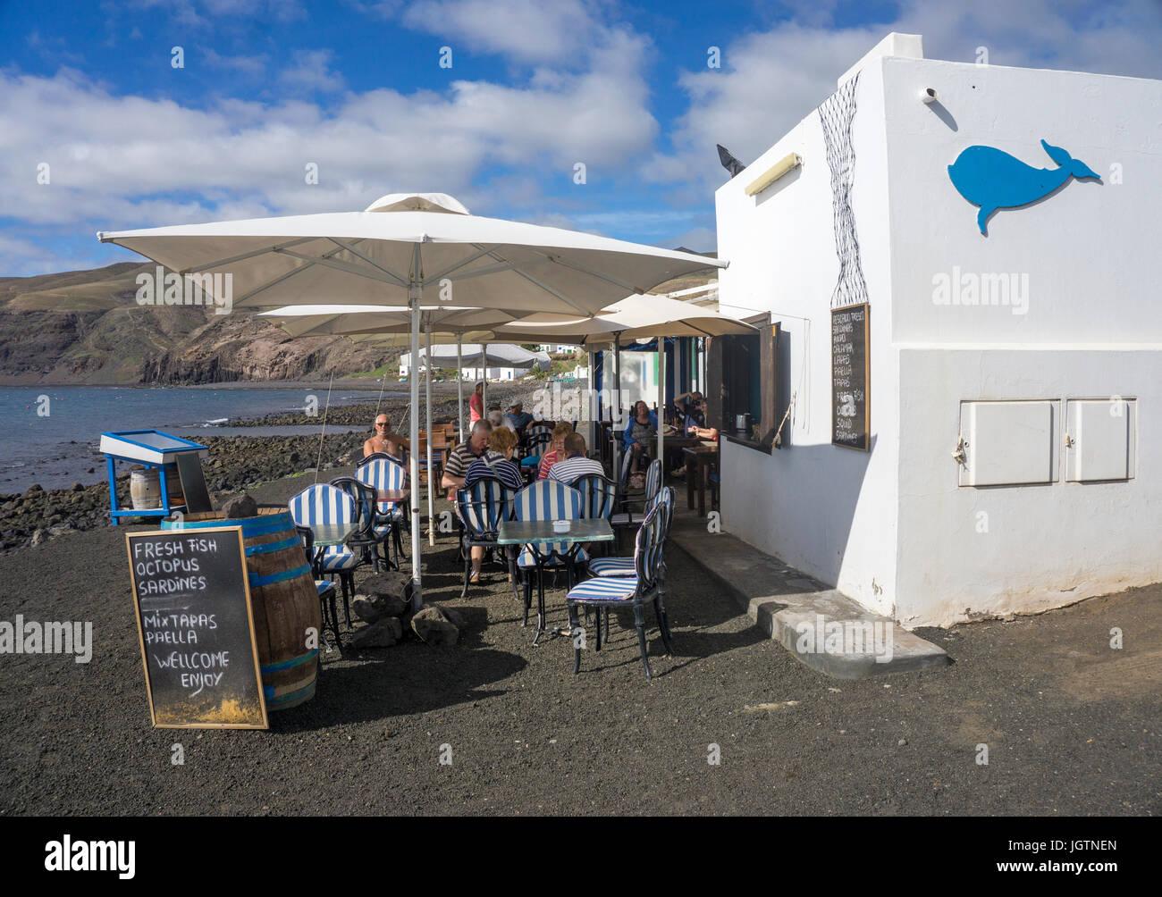 Fish restaurant at the beach of the fishing village Playa Quemada, Lanzarote island, Canary islands, Spain, Europe Stock Photo