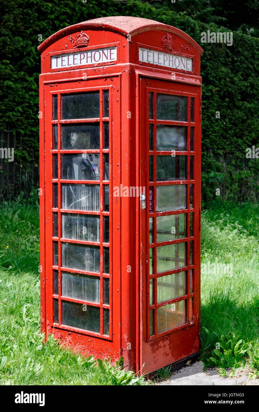 Red telephone booth, Cambridge, Cambridgeshire, England, United Kingdom - Stock Image