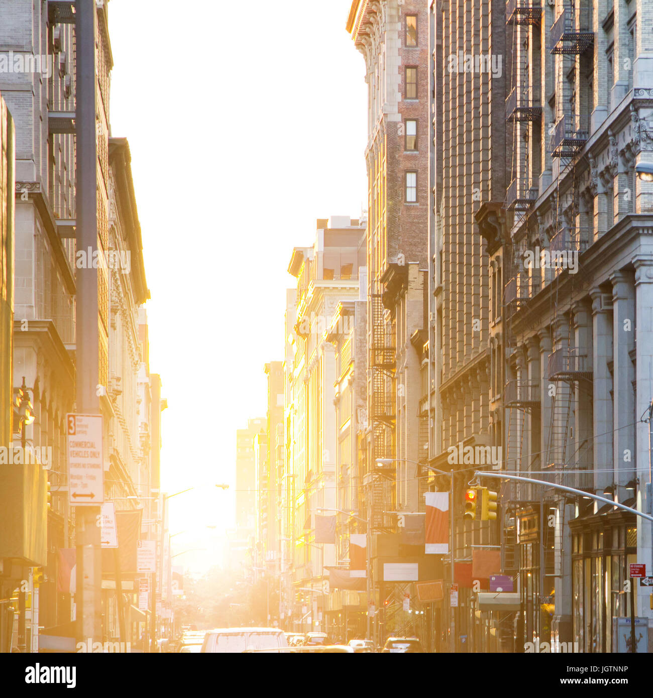 Sunlight shines down the streets of New York City - Stock Image