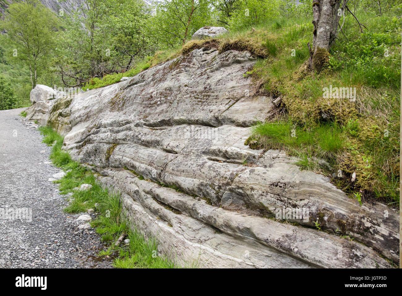 Horizontal scratch lines or striations gauged in rock by receding Briksdal glacier in Briksdalen or Briks valley. - Stock Image