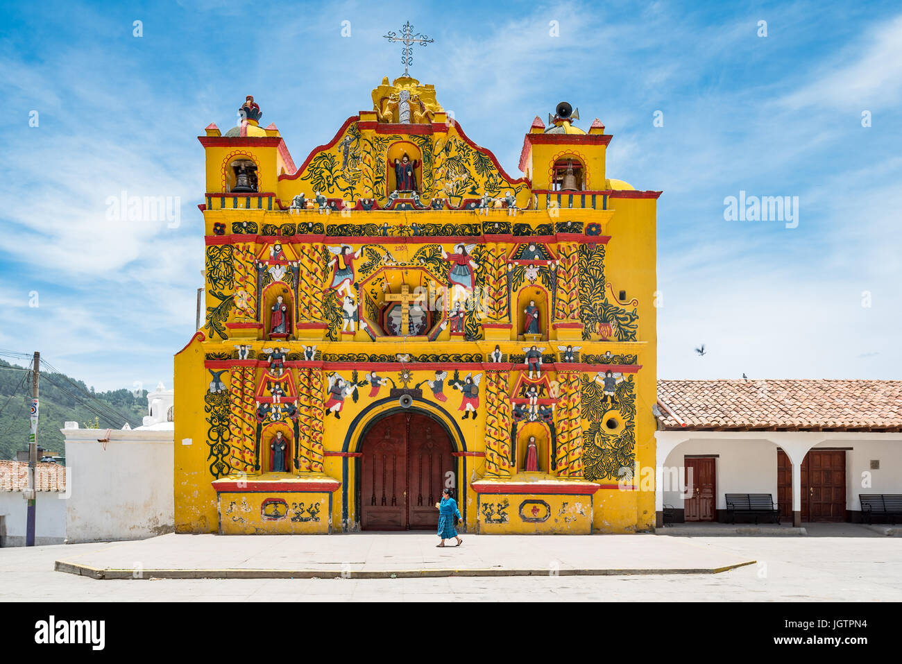 A small village in the Western Highlands of Guatemala, San Andrés Xecul is home to a brightly-painted Catholic - Stock Image