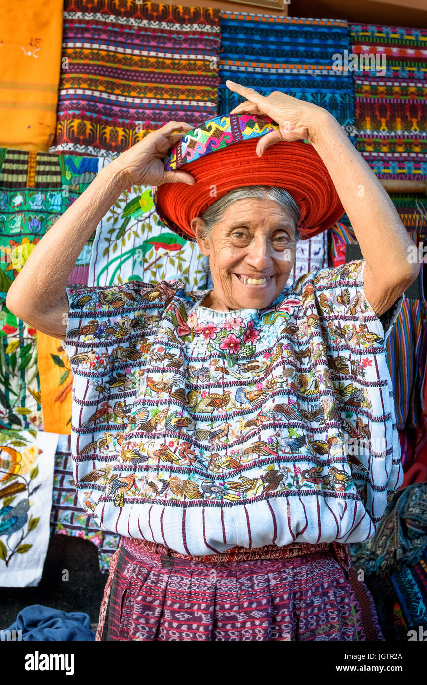 An older Indegenous Mayan woman wearing traditional dress, including a tocoyal or head wrap typical hat of Santiago Stock Photo