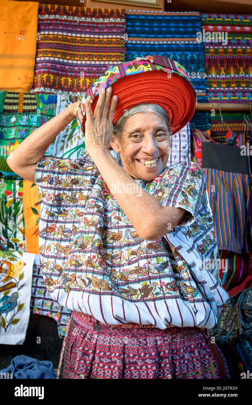 An older Indegenous Mayan woman wearing traditional dress, including a tocoyal or head wrap typical hat of Santiago - Stock Image