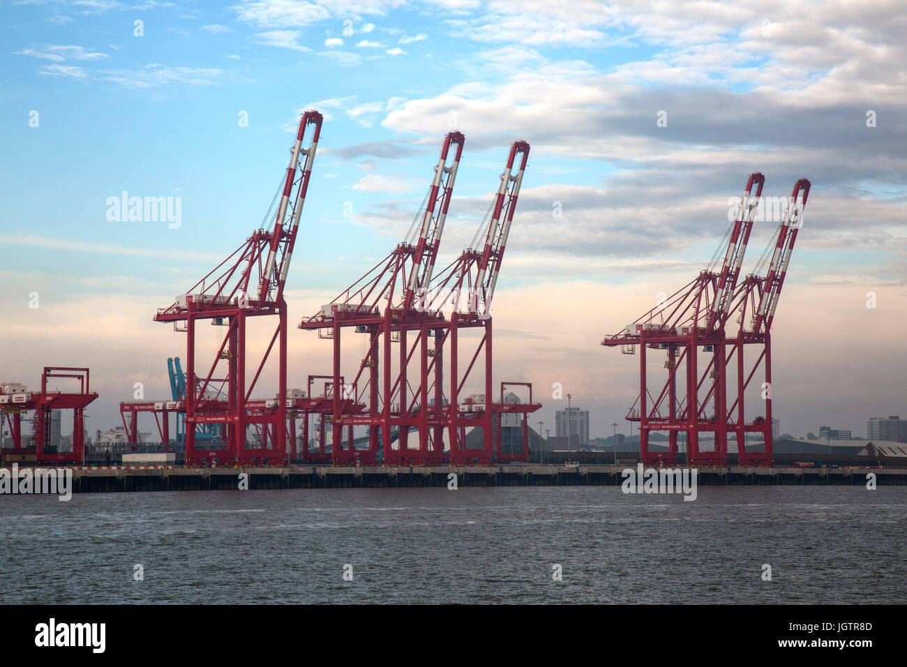 Large cranes at the mouth of The River Mersey, entering Liverpool in England. - Stock Image