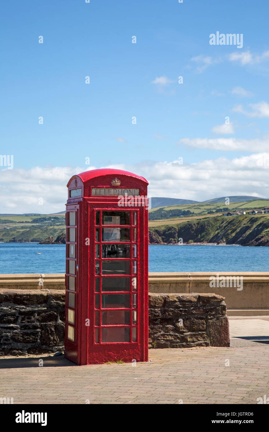 British red telephone box in the harbour in the town of Peel on the Isle of man - Stock Image
