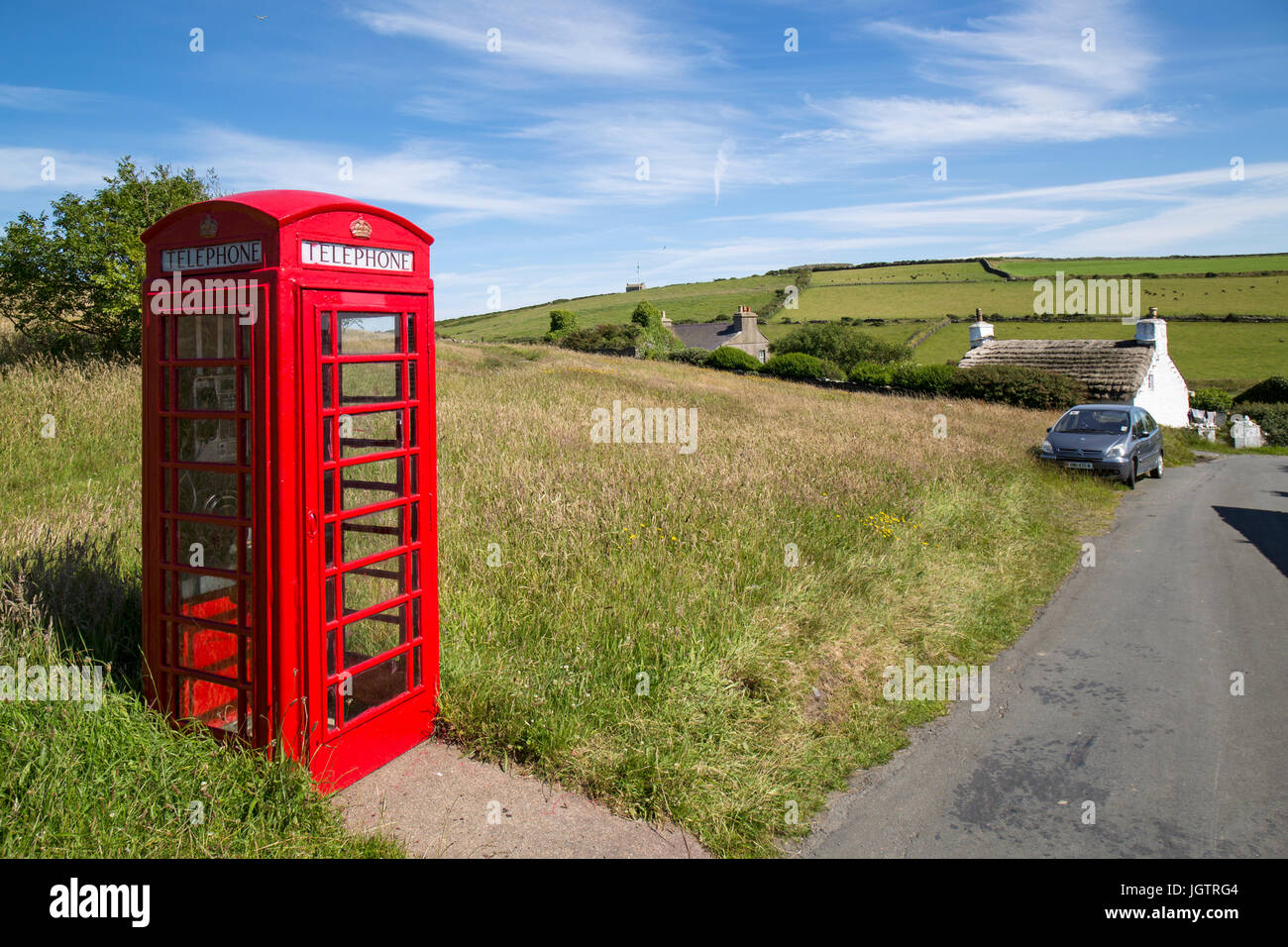 British red telephone box in the village of Cregneash on The Isle of Man. - Stock Image