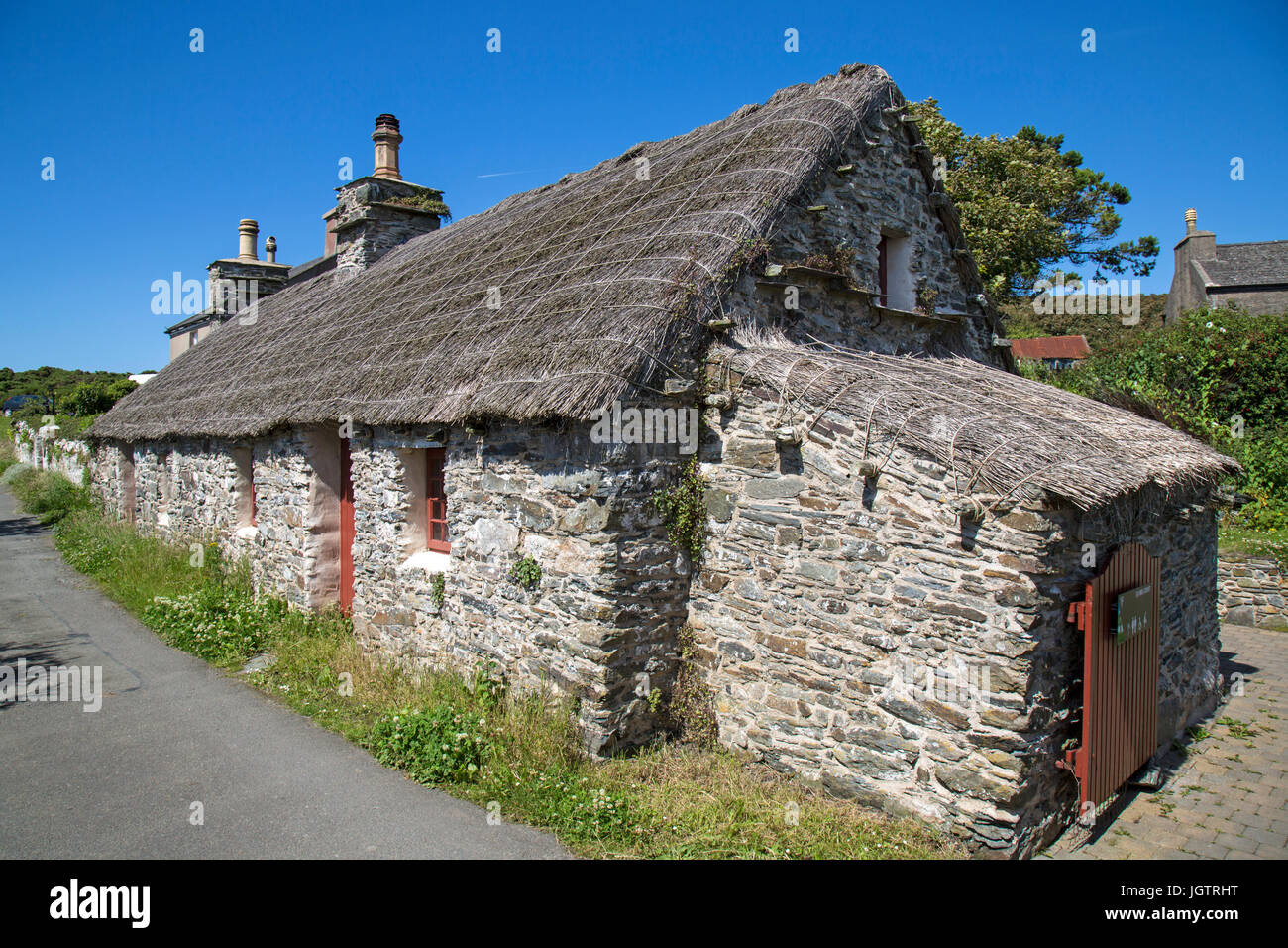 Thatched cottage in the preserved village of Cregneash on The Isle of Man. - Stock Image