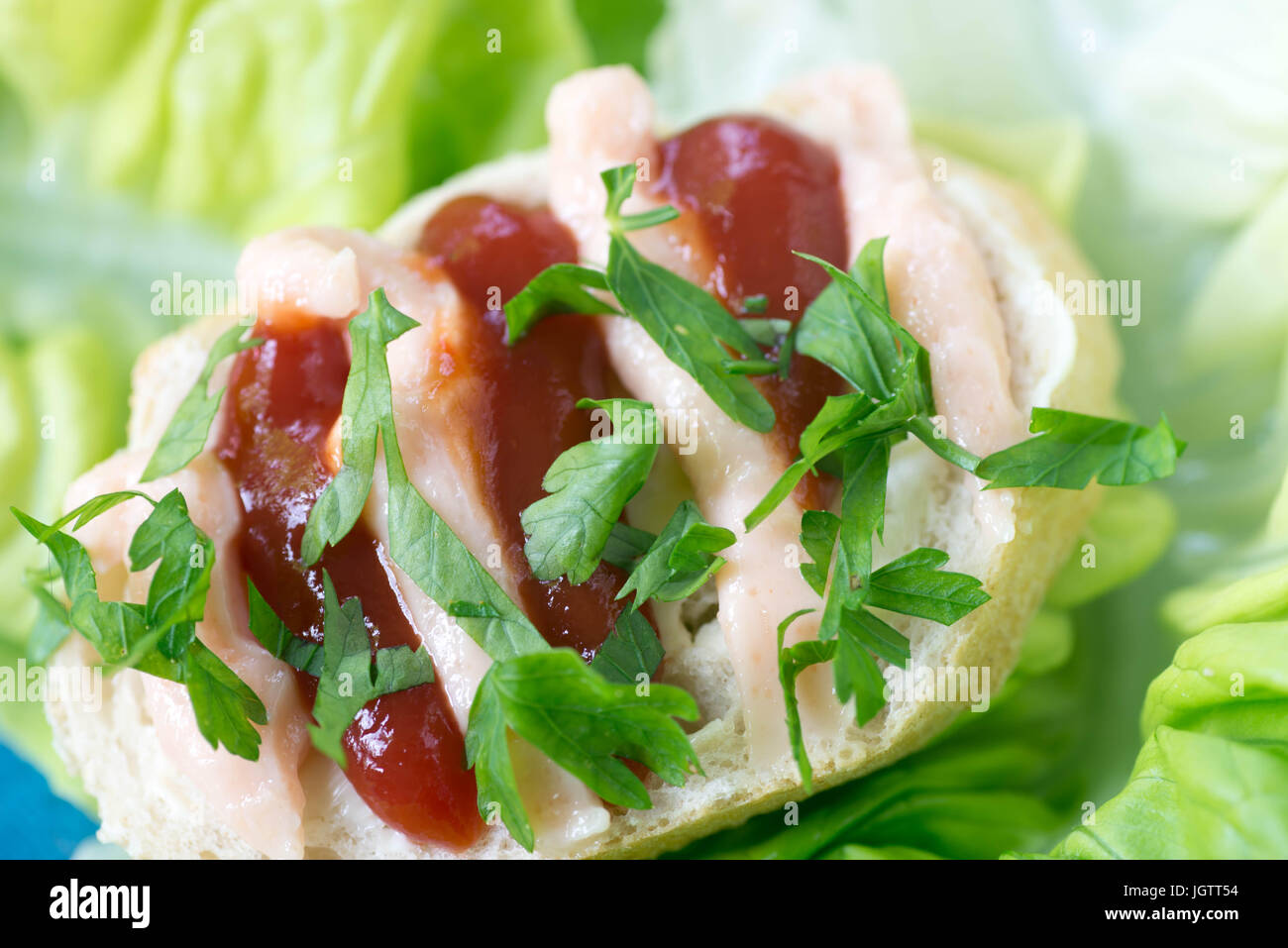 healthy small open sandwich with ketchup and fish paste selective focus macro - Stock Image