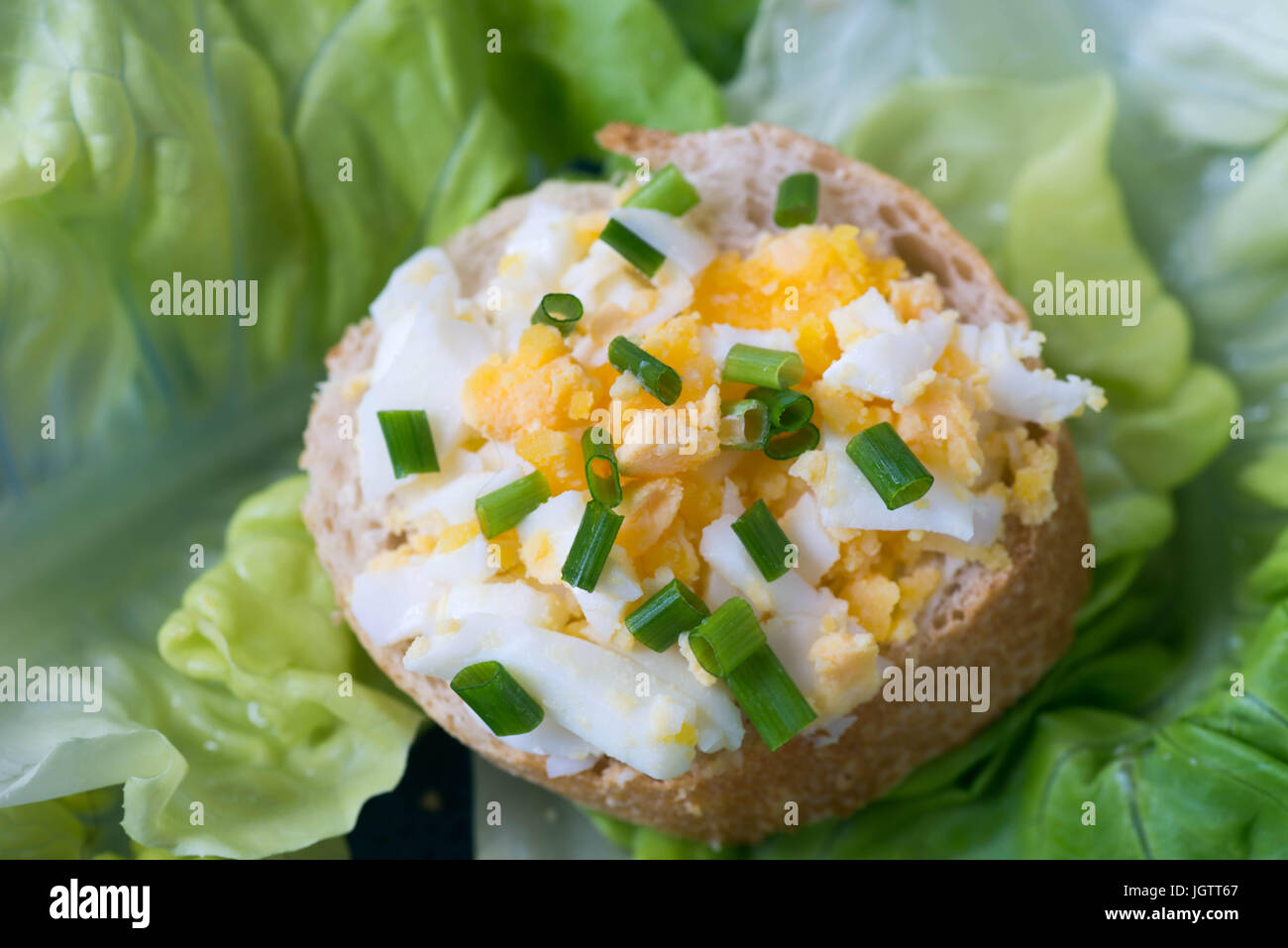 healthy small open sandwich with egg and chives selective focus macro - Stock Image