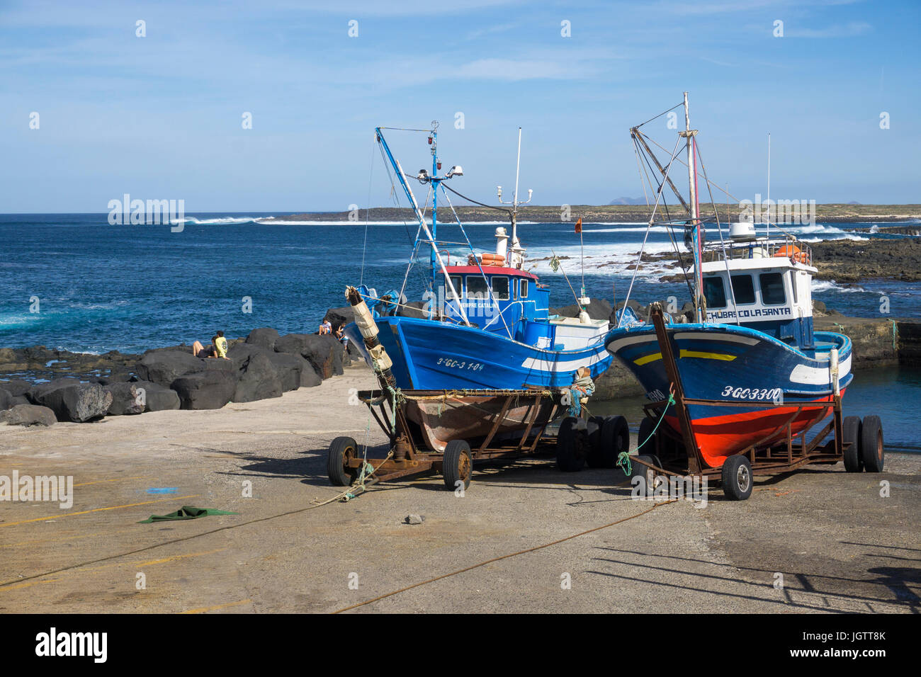 Two fishing boats on trailer at the harbour slip, village La Santa at north coast of Lanzarote island, Canary islands, - Stock Image