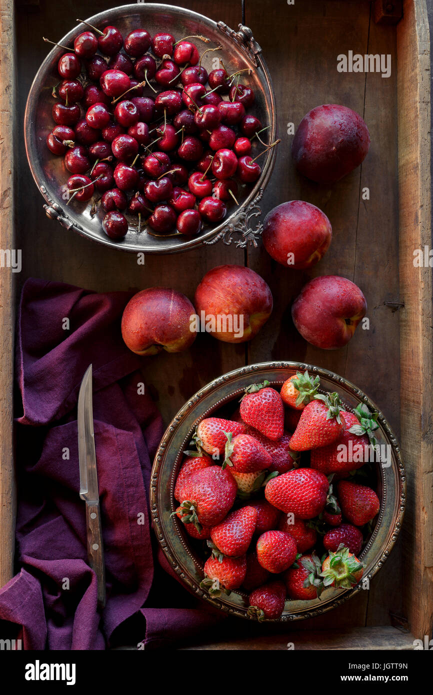 Summer fruit ingredients, including cherries, strawberries and peaches - Stock Image