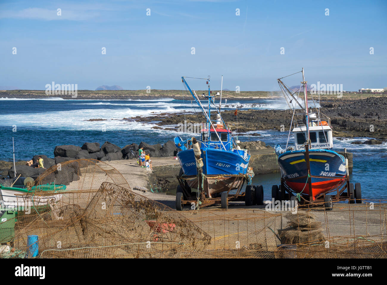 Two fishing boats on trailer at the harbour, village La Santa at north coast of Lanzarote island, Canary islands, Stock Photo