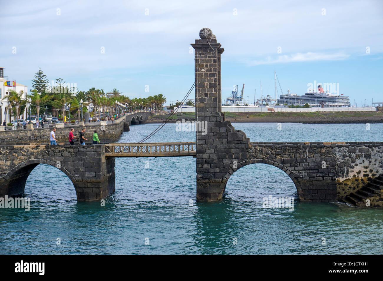 Drawbridge Puente de las Bolas (Bowl bridge), connect Arrecife with fortress Castillo de San Gabriel, Arrecife, Stock Photo