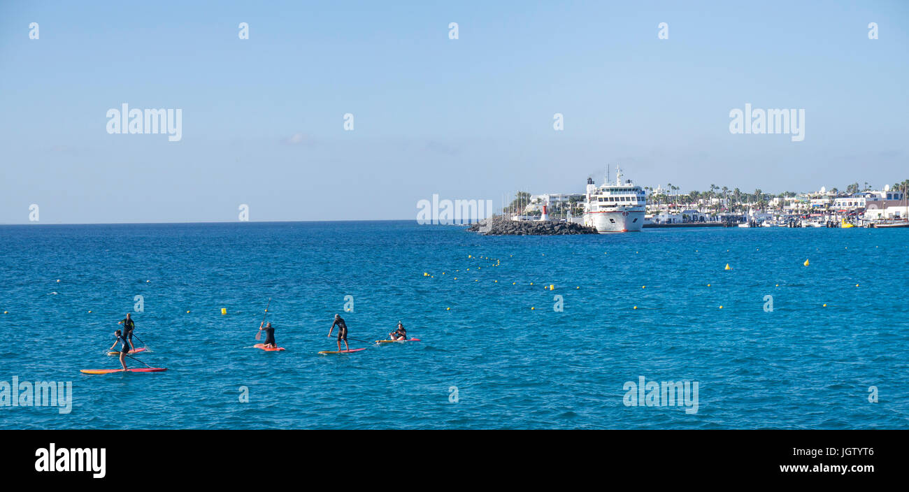 Stand-up Paddling at Playa Blanca, Lanzarote island, Canary islands, Spain, Europe - Stock Image