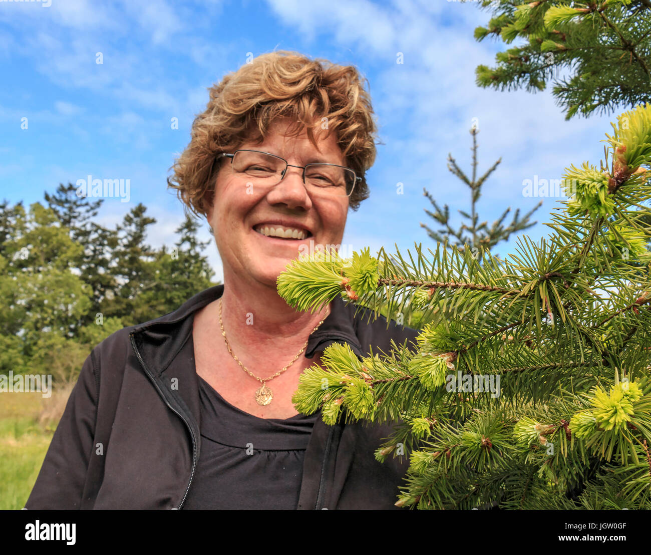 Laura Waters at her shop, Snowdon House outside Victoria, BC, Canada on Vancouver Island, where she sells edibles made from new growth on douglas fir  Stock Photo