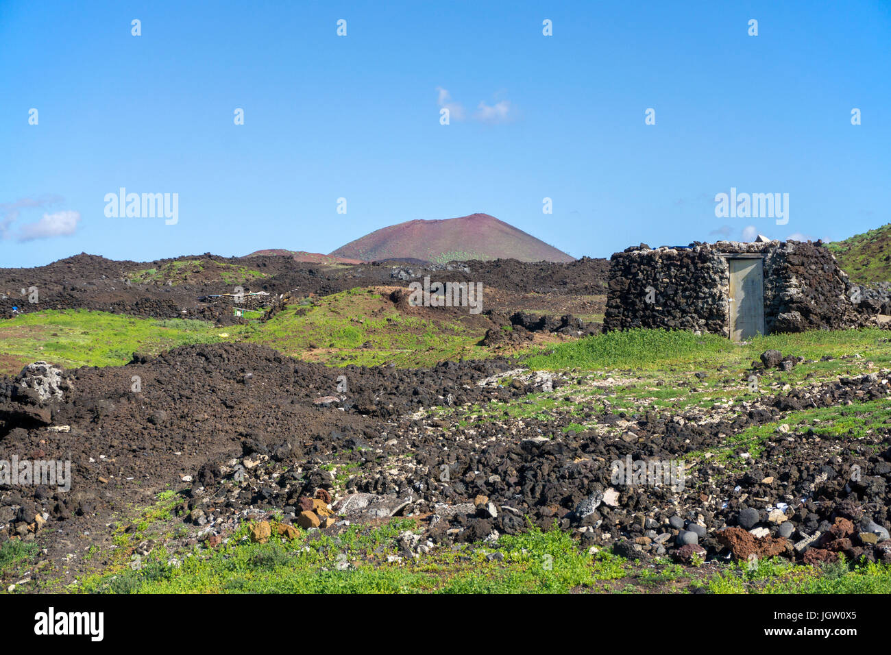 Tiny country house built with lava stones at the fishing village El Golfo, Lanzarote island, Canary islands, Spain, Stock Photo