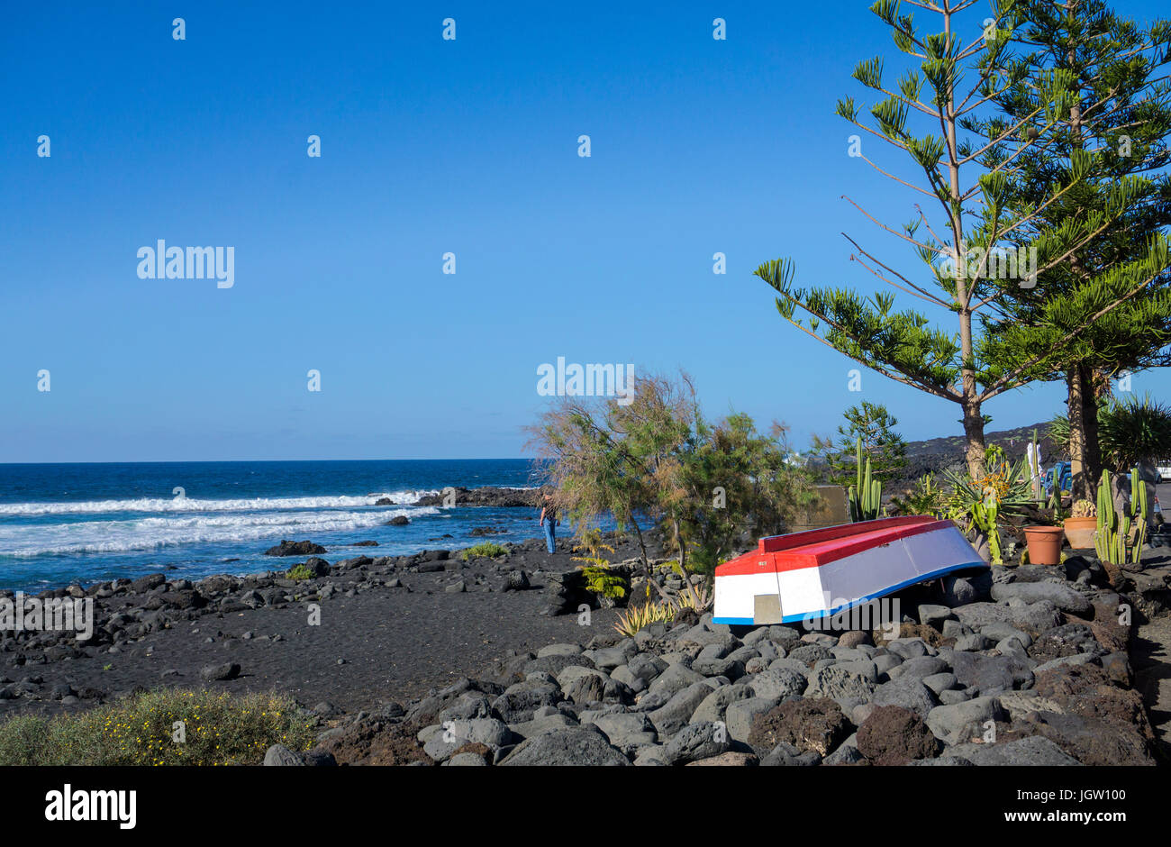 Fishing boat at the pebble beach of fishing village El Golfo, Lanzarote island, Canary islands, Spain, Europe - Stock Image