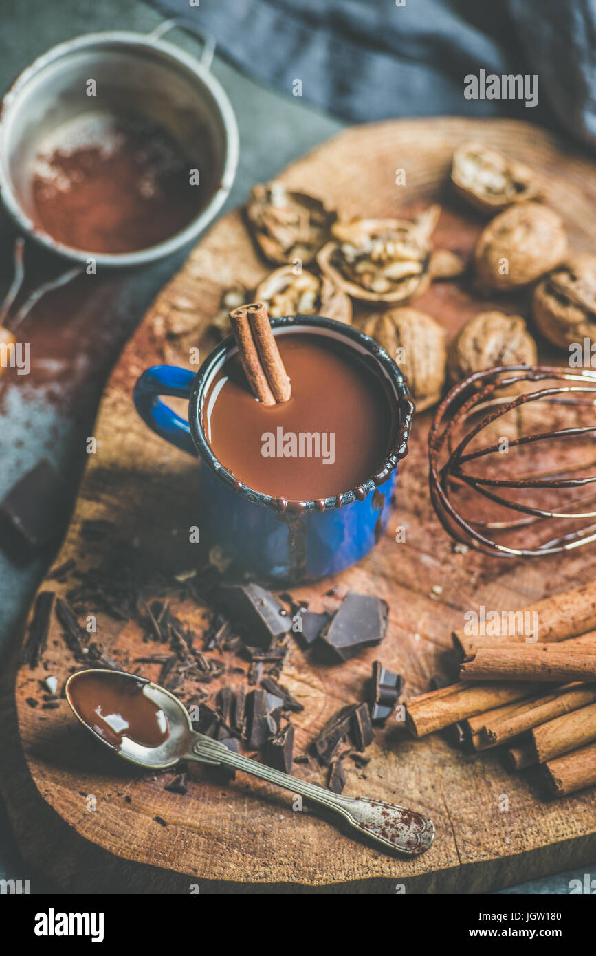 Homemade rich hot chocolate with nuts and cinnamon - Stock Image