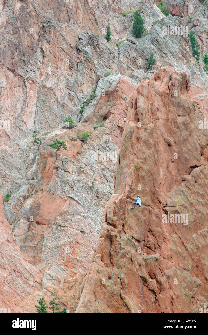 Rock climber at Garden of the Gods, Colorado Springs, Colorado, USA - Stock Image