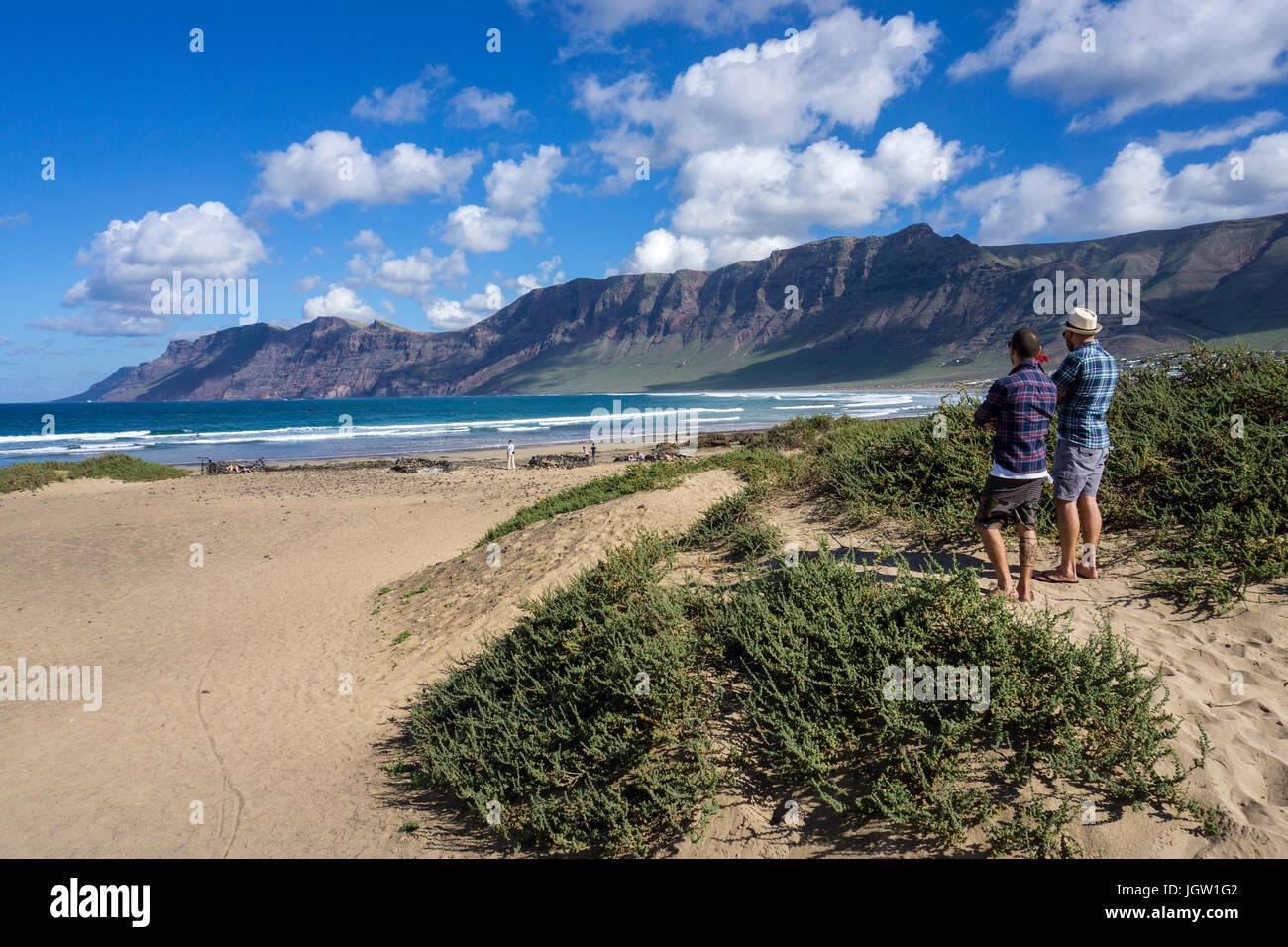 Sand dunes at Playa de San Juan, behind the Famara-cliff, La Caleta de Famara, Lanzarote island, Canary islands, - Stock Image