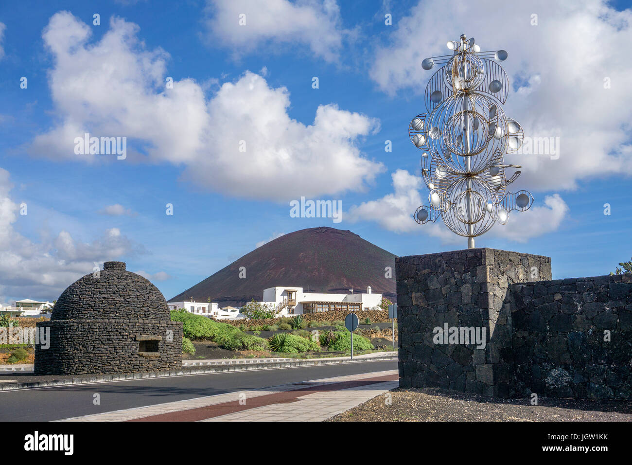 Silver wind chime, sculpture at a crossroad, exit to Fundacion Cesar Manrique, Tahiche, Lanzarote island, Canary - Stock Image