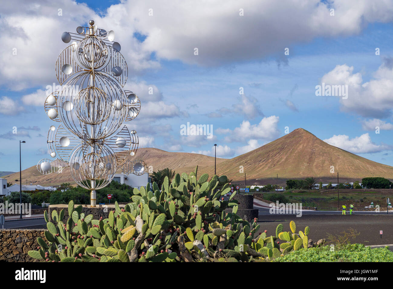 Silver wind chime, sculpture at a crossroad, exit to Fundacion Cesar Manrique, Tahiche, Lanzarote island, Canary Stock Photo