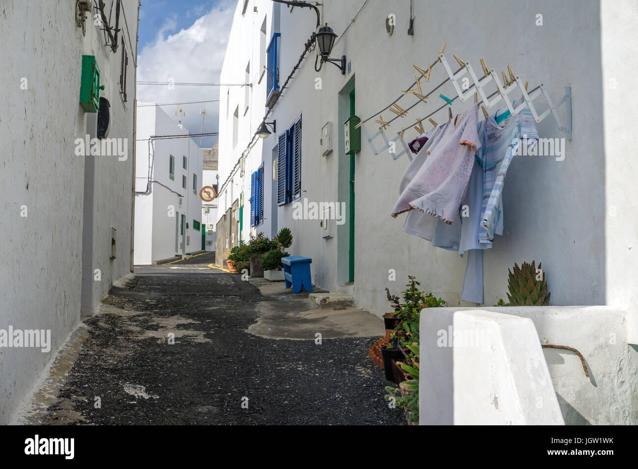 Outhanging laundry at alley, Punta Mujeres, fishing village north of Lanzarote island, Canary islands, Spain, Europe - Stock Image