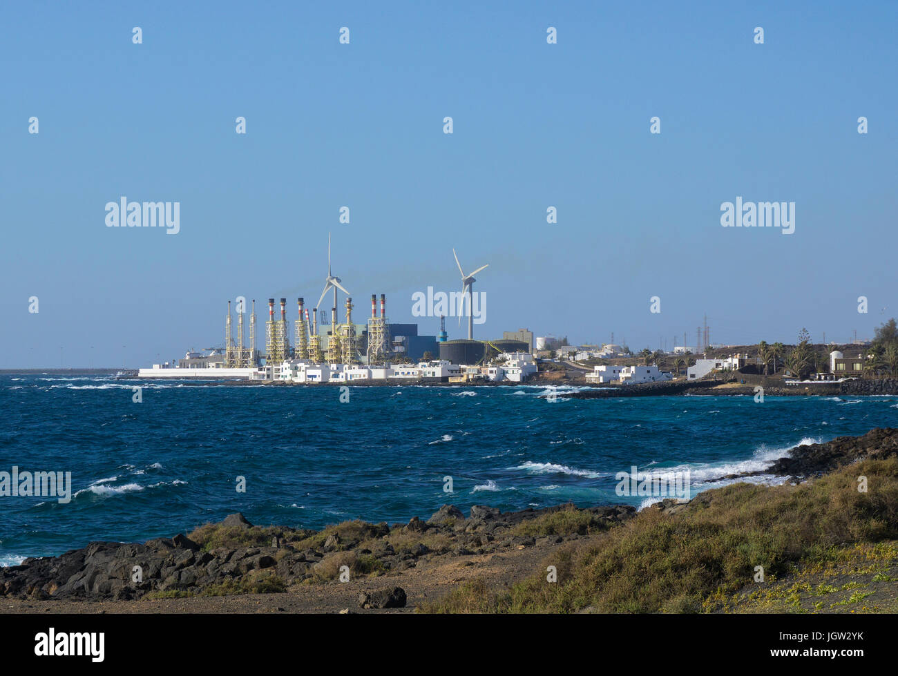 View from rocky coast of Teguise on desalination facility of Arrecife, Canary islands, Spain, Europe Stock Photo