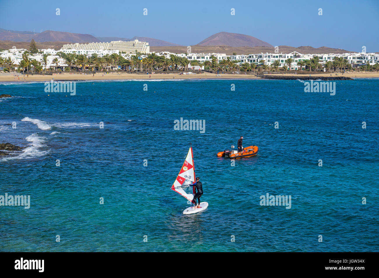 Wind surfer at Playa de las Cucharas, bathing beach at Costa Teguise, Lanzarote, Canary islands, Europe - Stock Image