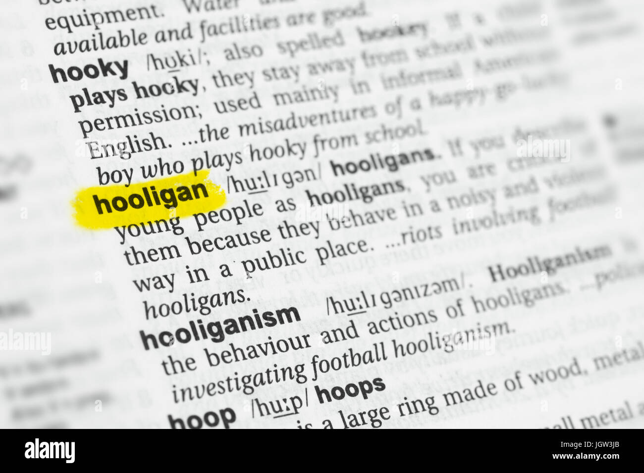 "Highlighted English word ""hooligan"" and its definition at the dictionary. Stock Photo"