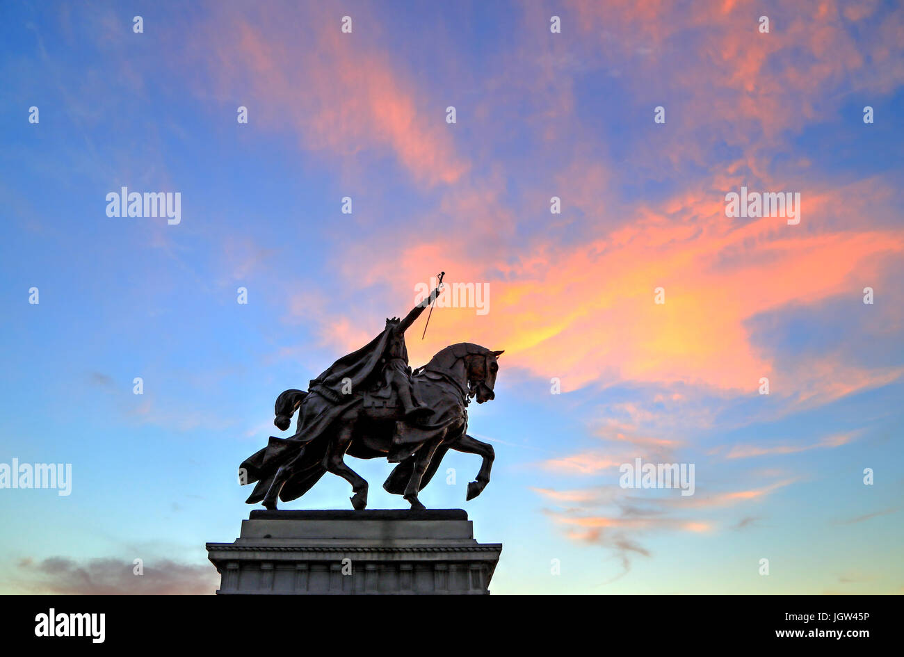 The sunset over the Apotheosis of St. Louis statue of King Louis IX of France, namesake of St. Louis, Missouri in - Stock Image