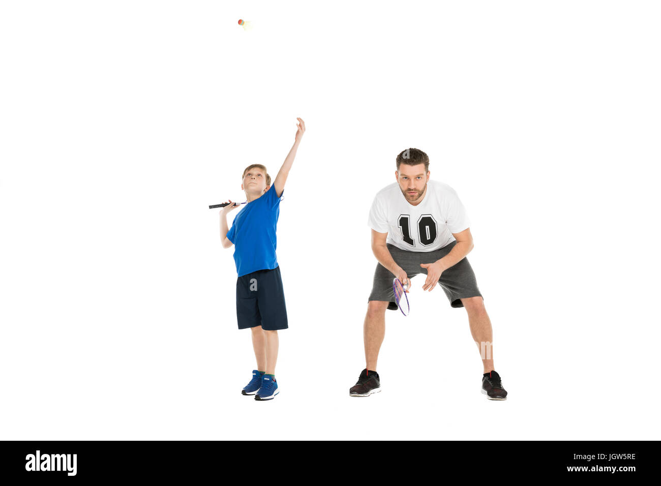 active father and son playing tennis together isolated on white - Stock Image