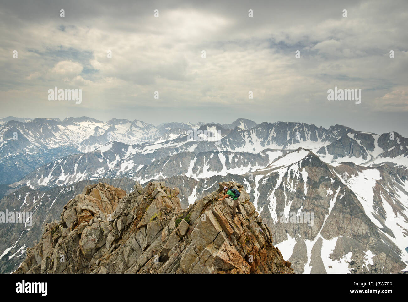 a man in the distance climbing the ridge of Mount Emerson in the Sierra Nevada Mountains - Stock Image
