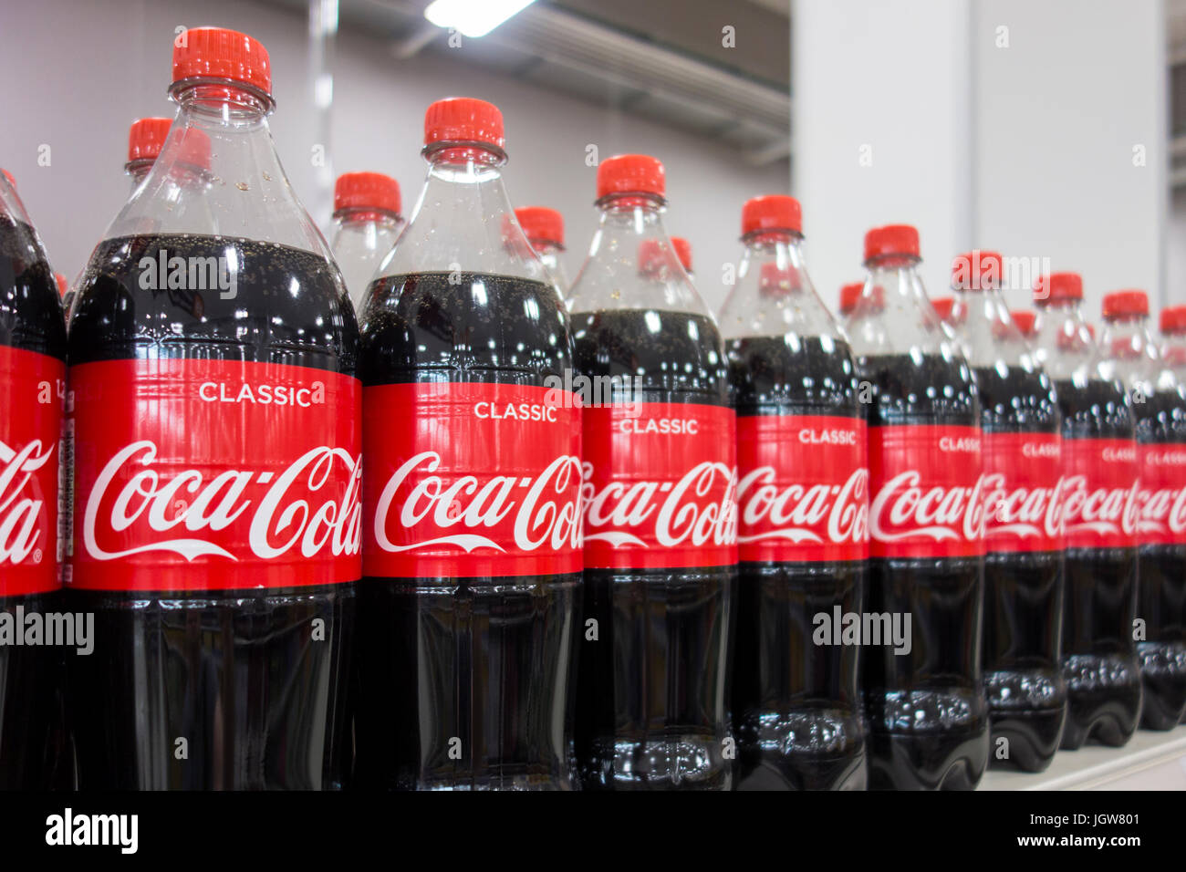 Bottles of Coca Cola / Coke for sale on a supermarket shelf in the UK - Stock Image