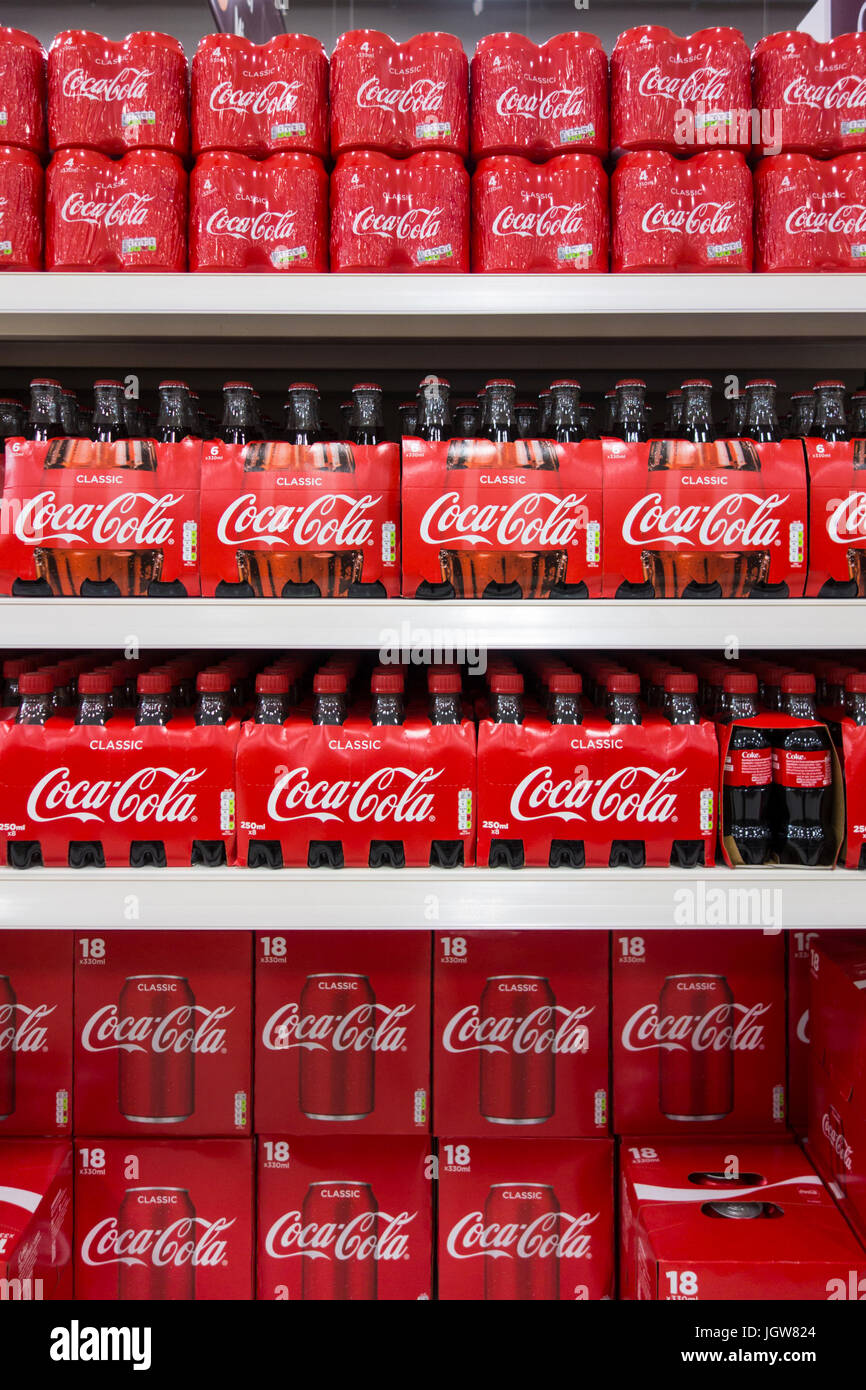 Coca Cola / Coke for sale on a supermarket shelf in the UK - Stock Image